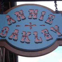 Annie Oakley storefront sign